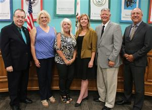 Board Trustees and Superintendent Pat Kelley pose with Linda Lunn