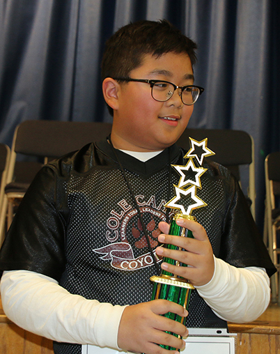 Joshua Velez wins district spelling bee