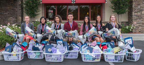 Students of the Year pose with baskets of goodies