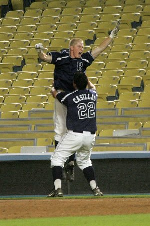 Ronnie Sims celebrates 11th inning bases loaded game winning RBI, Broncos win 1-0.
