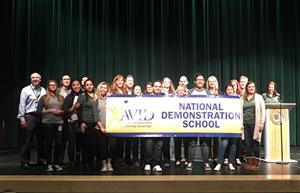 students hold AVID banner