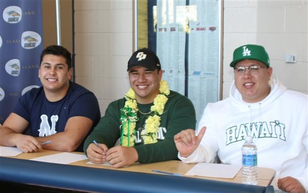 Vista Murrieta students shown smiling at signing ceremony